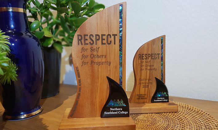 Rimu, Paua 2 tier trophy. Beautiful curves to compliment the natural beauty of Paua and Rimu combination. Designed to suit the wording for your awards